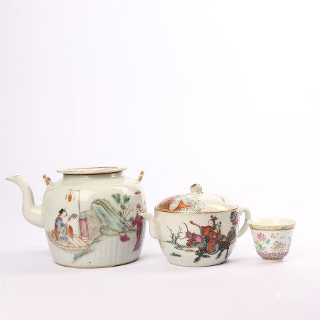 A set of teapots and cups decorated with famille rose figures and flowers