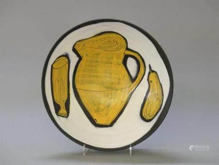 Jacques INNOCENTI (1926-1958)Coupe en céramique à décor d'une nature morte au pichet et poire.