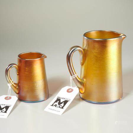 (2) Favrile glass pitchers, incl. Tiffany