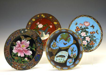 Four assorted early 20th Century Oriental cloisonné dishes, each approximately 30cm diameter (4)