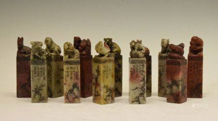 Set of twelve Chinese soapstone desk seals, each surmounted by a differing animal symbolising the