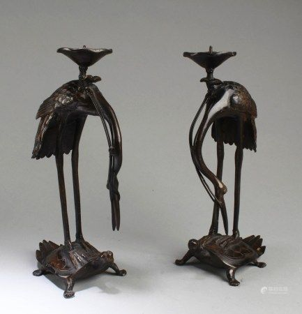 A Pair of Bronze Candle Holders