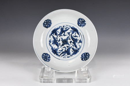 A LARGE BLUE AND WHITE CHARGER MING