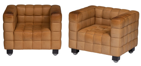 A pair of leather upholstered Kubus Armchairs