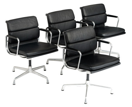 A set of four polished aluminium and black leather upholstered EA208 soft pad chairs