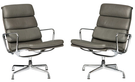 A set of two chromed aluminium and grey leather upholstered EA216 softpad lounge chairs