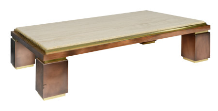 A vintage polished brass coffee table with a travertine tabletop