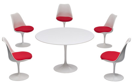 A dining set of a Tulip table and five Tulip chairs
