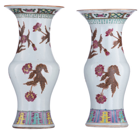 Two Chinese polychrome and famille rose floral decorated yenyen-vases
