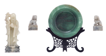 A Chinese spinach jade dish on a sculptedwooden stand; added a ditto pale jade sculpture