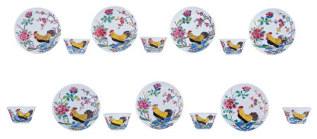 Seven famille rose cups and matching saucers
