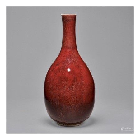 A COPPER-RED-GLAZED BOTTLE VASE,  QING DYNASTY, KANGXI PERIOD
