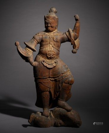 A CARVED WOOD FIGURE OF GUARDIAN KING