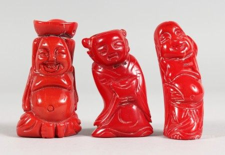 THREE CHINESE CARVED CORAL FIGURES. 2.25ins x 2.5ins high.