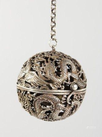 A CHINESE PIERCED SILVER BALL SHAPE CENSER. 2.25ins diameter.
