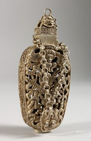 A CHINESE PIERCED SILVER BOTTLE. 4.5ins high.