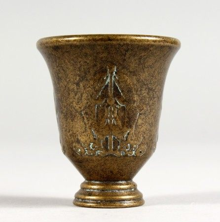 A CHINESE BRONZE MINIATURE WINE CUP. 2ins high.