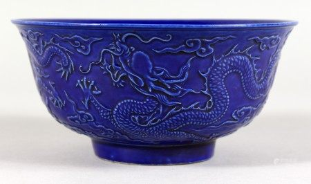 A DARK BLUE GROUND CHINESE BOWL with moulded decoration. 6ins diameter.