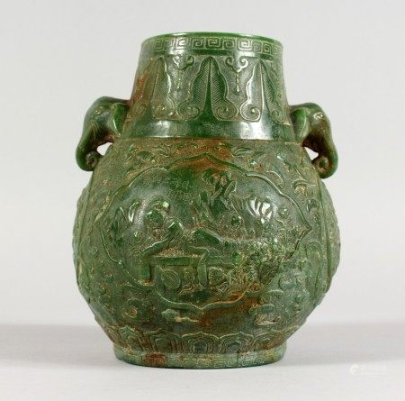 A CHINESE CARVED JADE VASE with elephant head handles. 6.5ins high.