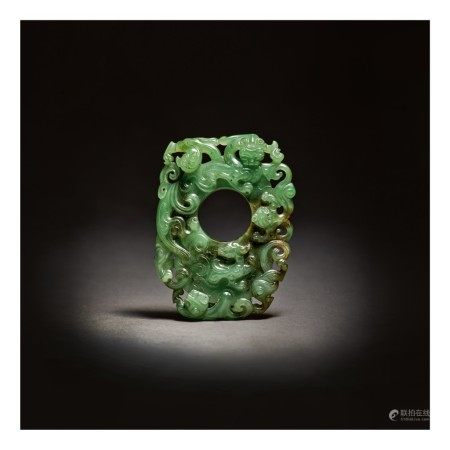 A SUPERB ARCHAISTIC SPINACH-GREEN JADE PENDANT,  QING DYNASTY, QIANLONG PERIOD