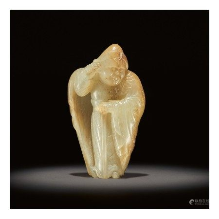 AN EXCEEDINGLY RARE WHITE AND RUSSET JADE CARVING OF A FOREIGNER,  TANG DYNASTY