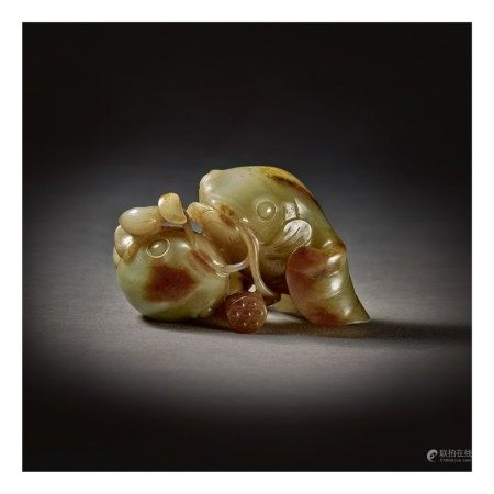 A GREEN AND RUSSET JADE 'GOLDFISH' GROUP,  17TH / 18TH CENTURY