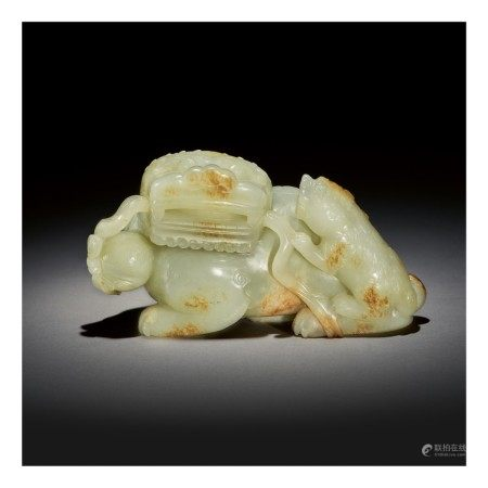 A LARGE PALE CELADON AND RUSSET JADE 'BUDDHIST LION' GROUP,  QING DYNASTY, QIANLONG PERIOD