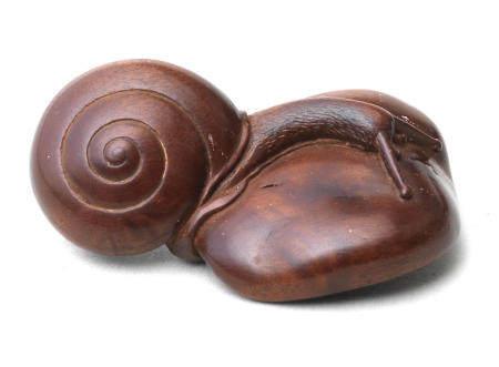 A boxwood netsuke of a snail on a shiitake mushroom By Soho, 19th century