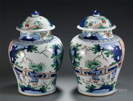 A PAIR OF CHINESE FAMILLE ROSE PORCELAIN FIGURE LIDDED JAR