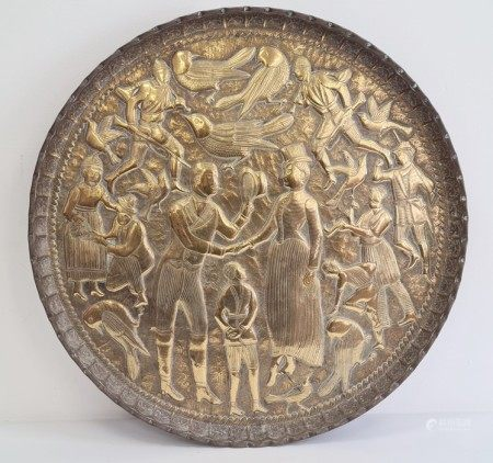 Eastern brass circular tray decorated with a western lady and gentleman shaking hands surrounded