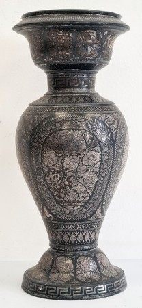 Indian metal baluster vasedecorated with silvered jardinieres of flowers, within oval foliate