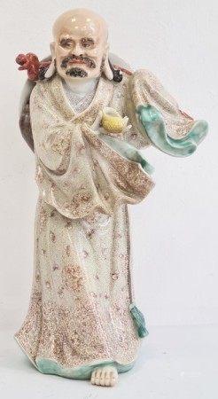 20th century Chinese porcelain figureof a man, impressed six-character mark to base, modelled