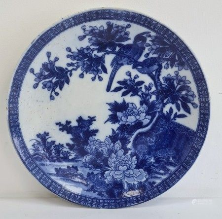 Chinese blue and white chargerdecorated with birds amongst trees and foliage, 37cm diameter