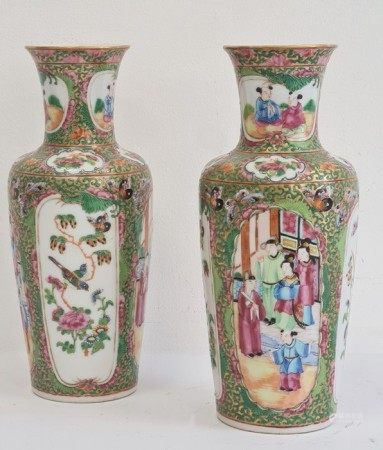 Pair of Chinese Canton baluster vases, each painted in a typical palette with figures on terracing