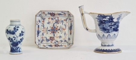Early 19th century Chinese export porcelain blue and white helmet-shaped jug, painted with a