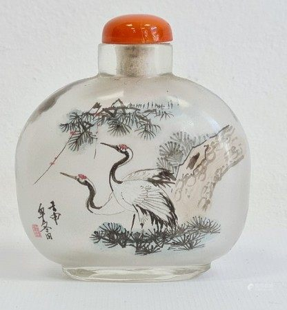 Two Chinese painted glass snuff bottlesand two glass covers, the largest painted with buildings and