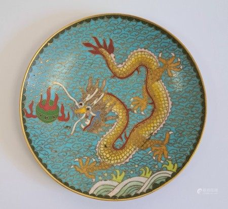 Chinese cloisonne saucer, decorated with a dragon chasing a flaming pearl, reserved on a blue