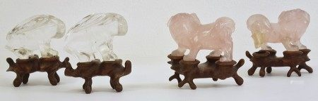 Pair of Chinese rose quartz modelsof lion dogs, 5cm long and a pair of quartz modelsof hares,