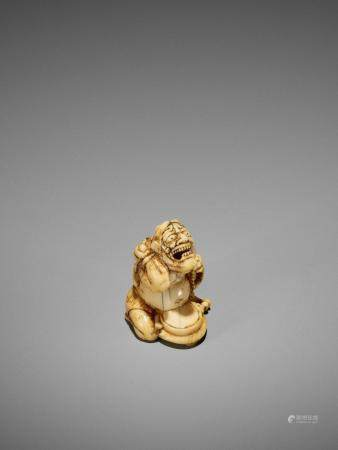 AN EARLY IVORY NETSUKE OF A REPENTING ONI