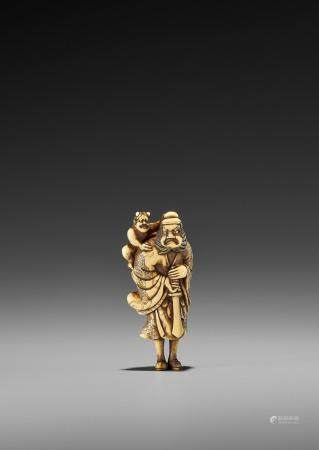 A FINE IVORY NETSUKE OF SHOKI AND ONI
