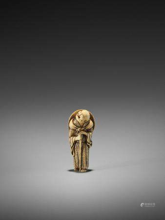 AN EARLY IVORY NETSUKE OF A PRIEST