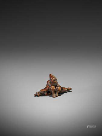 A WOOD NETSUKE OF A TEMPLE SERVANT (EJI)