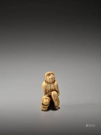 A RARE AND EARLY IVORY NETSUKE OF A MONKEY WITH YOUNG