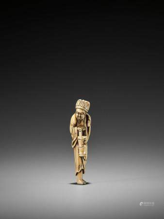 A VERY RARE TALL IVORY NETSUKE OF A CHINESE DOCTOR