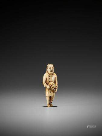 A RARE IVORY NETSUKE OF A DUTCH CHILD PLAYING THE DRUM