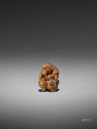 IKKO: A FINE WOOD NETSUKE OF A MONKEY WITH YOUNG
