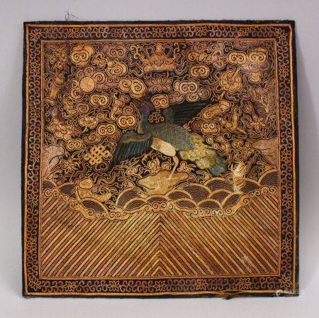 A CHINESE EMBROIDERED TEXTILE PANEL, depicting phoenix birds in landscapes with waves, mounted to