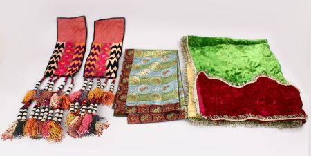 A LOT OF FOUR 20TH CENTURY IRANIAN TEXTILE COVERS, mixed sizes.
