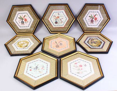 EIGHT CHINESE 19TH / 20TH CENTURY EMBROIDERED SILK PANELS - FRAMED, of hexagonal form, each with