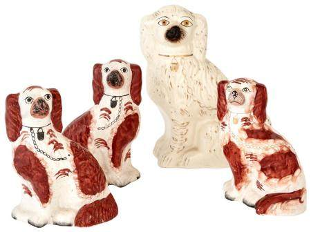 Group of Four Staffordshire Pottery Figures of Seated Spanie